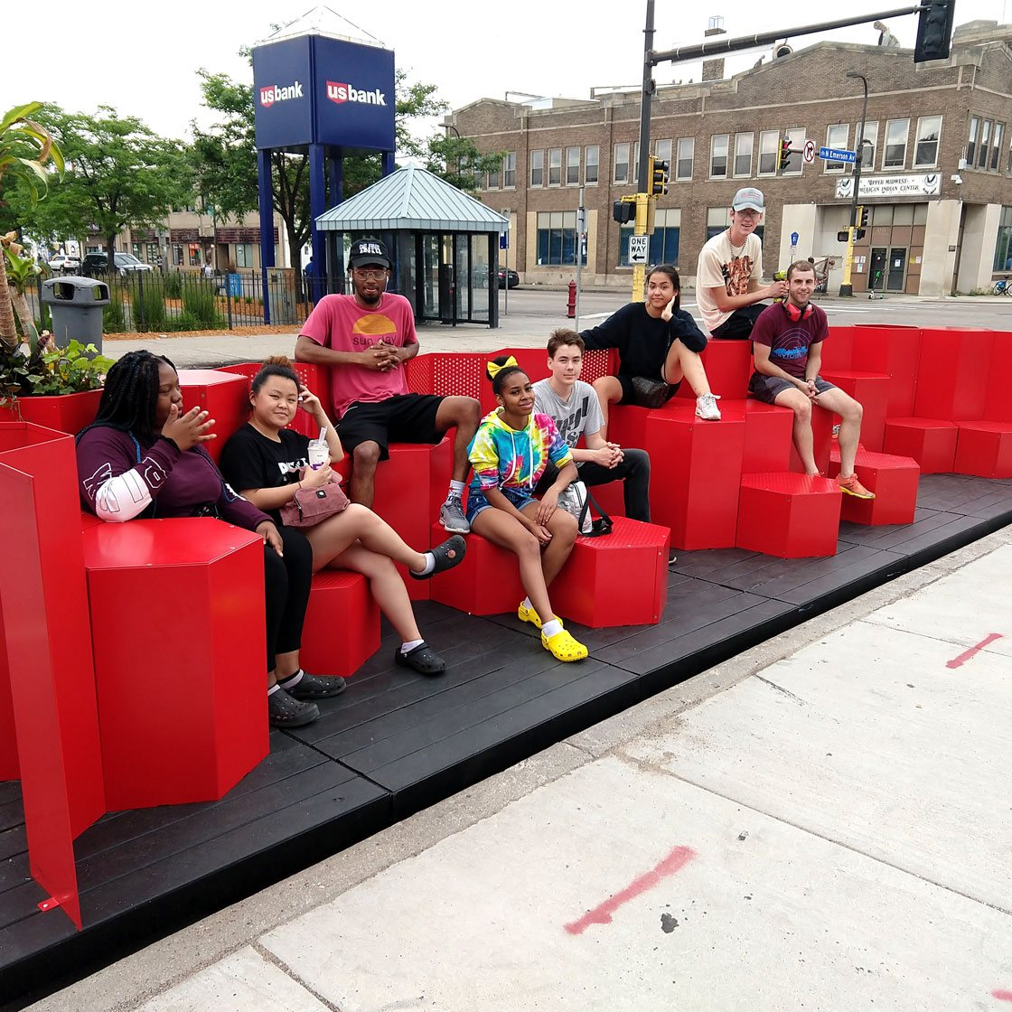 A group of people sitting on a modular seating area