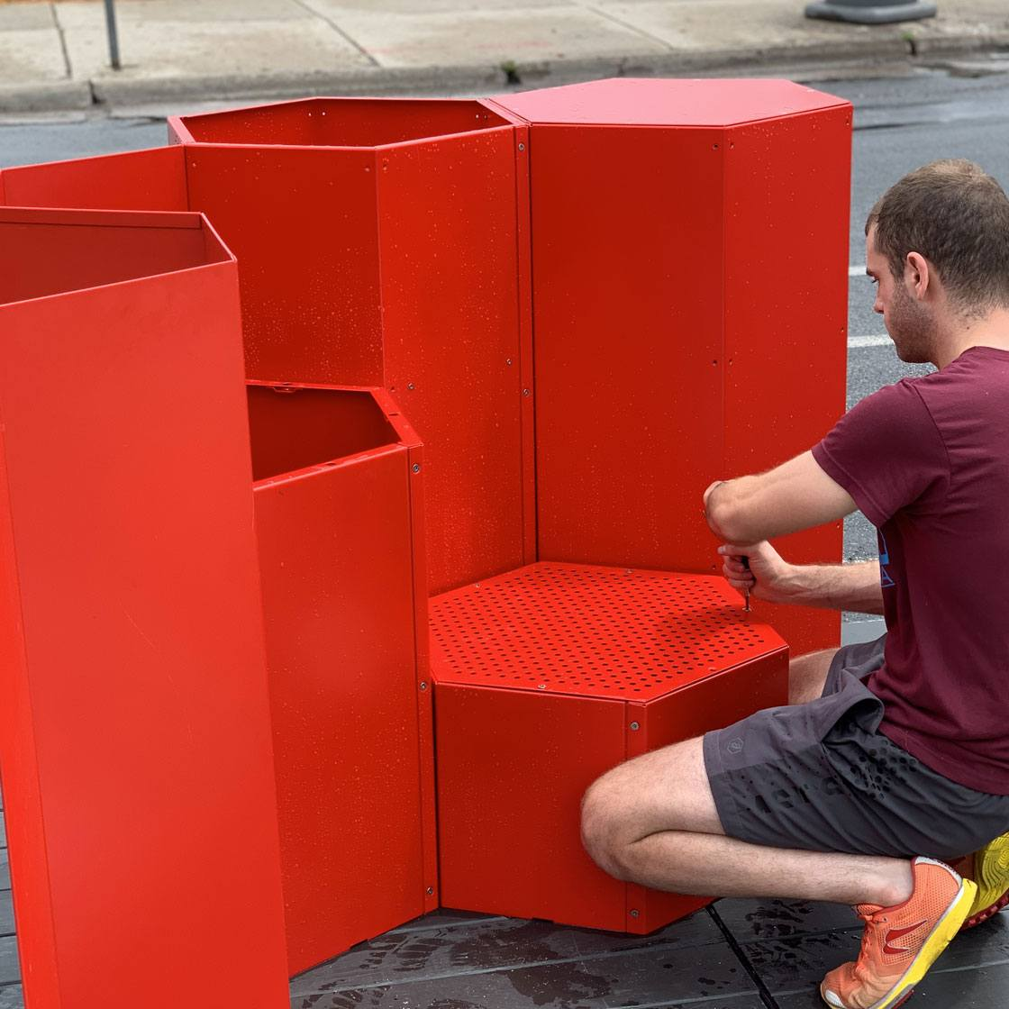 Someone constructing a modular seating-scape