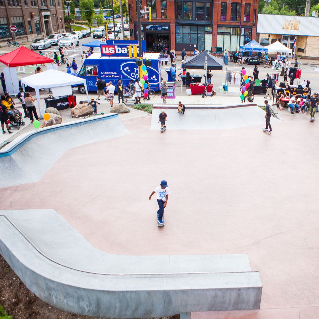 People milling about in a skate-able plaza