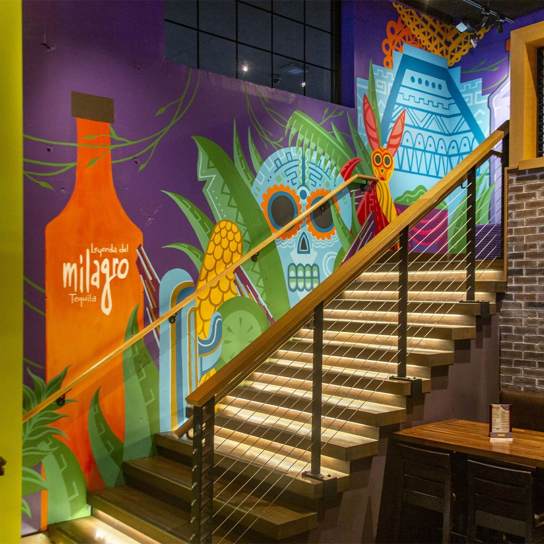 A colorful graphically illustrated mural inside a restaurant