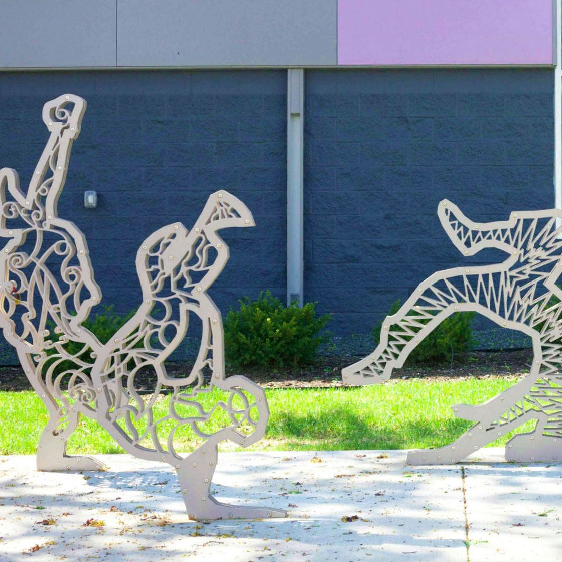 Bike racks in the shape of illustrative break dancers