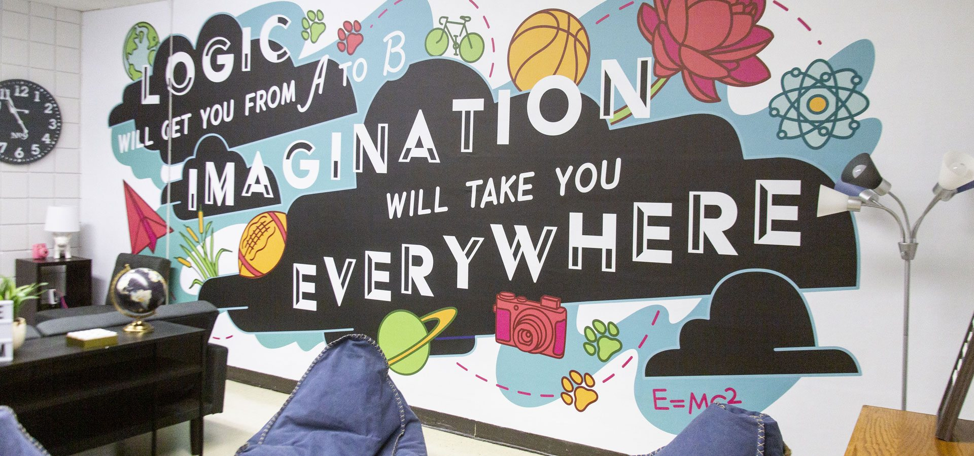 A decorative and digitally illustrated vinyl mural with the words logic will get you from A to B, imagination will take you everywhere