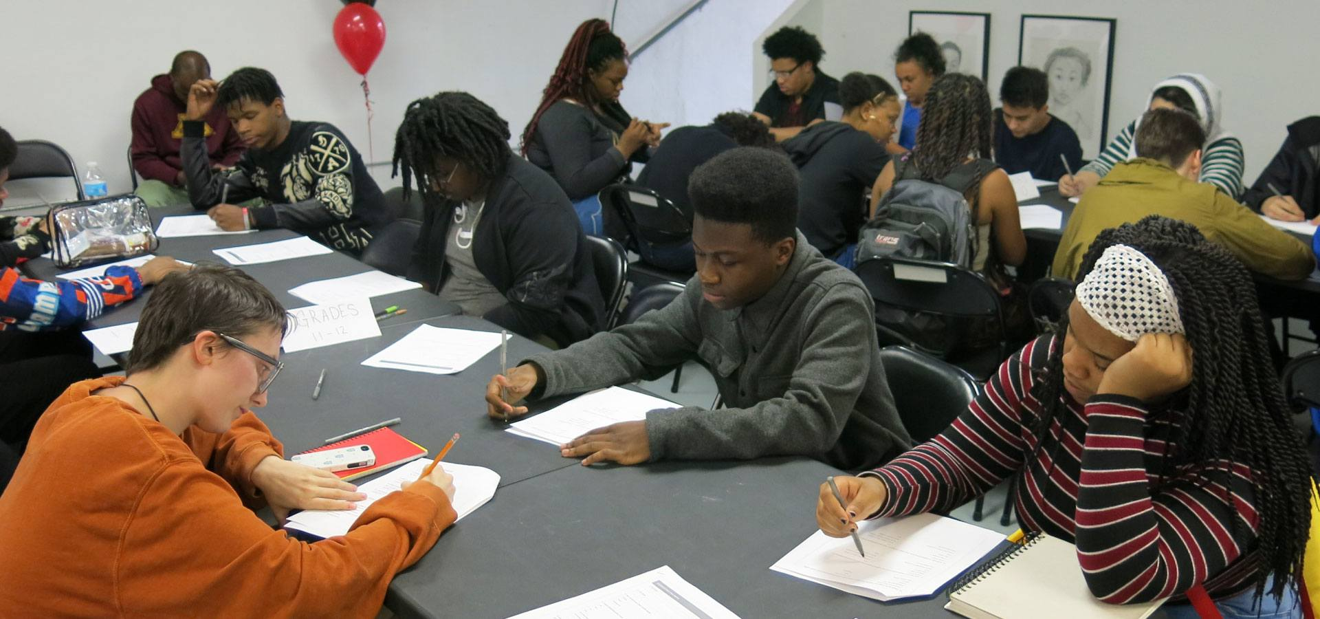Several young people working on reflection writings