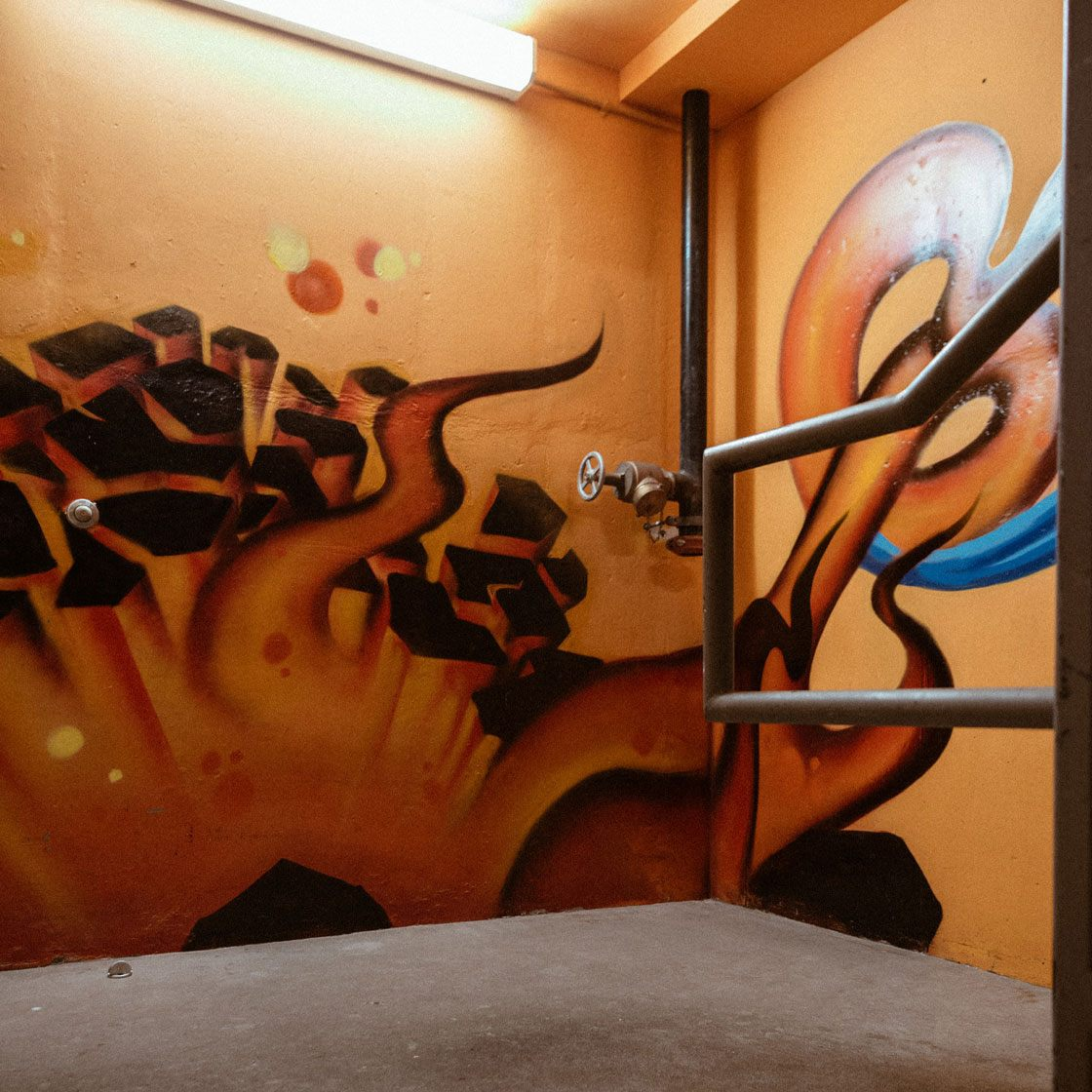 An abstract painted mural in an indoor staircase