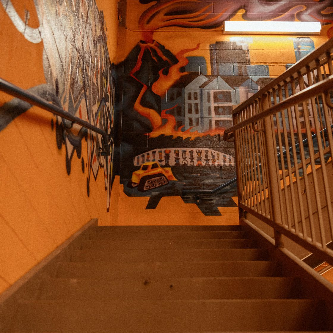 A painted mural in an indoor staircase
