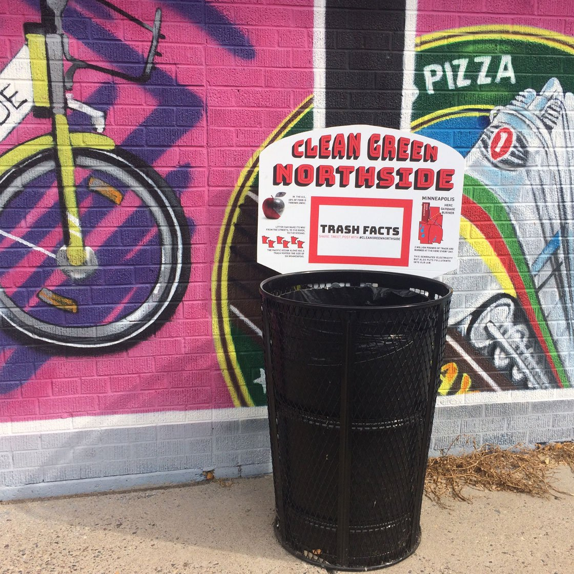 A trash can labeled with a sign reading clean green northside