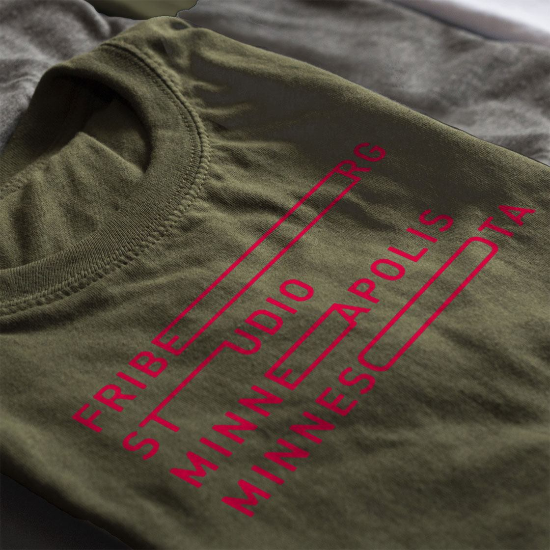 Closeup of screen printed t shirts with ken friburg logo