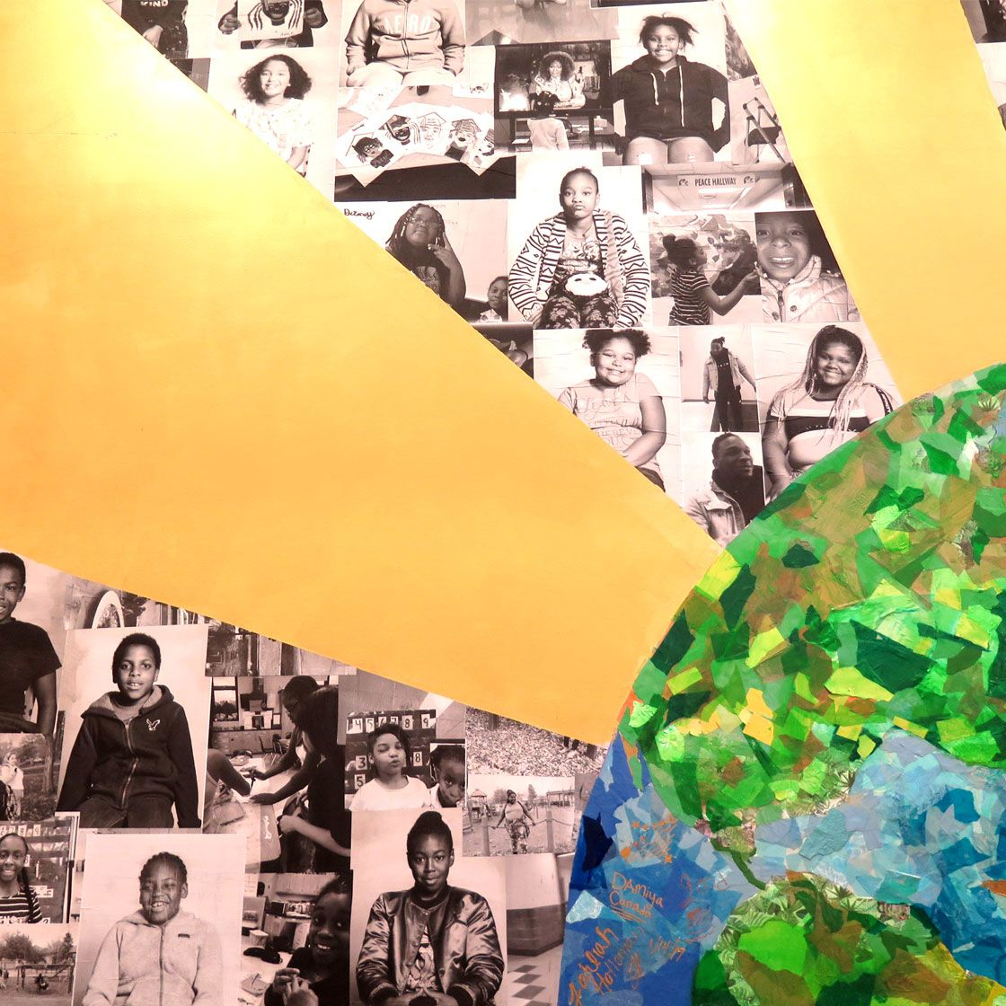 Closeup of a multimedia mural of an earth with sun rays coming out of it, collaged with photos of people
