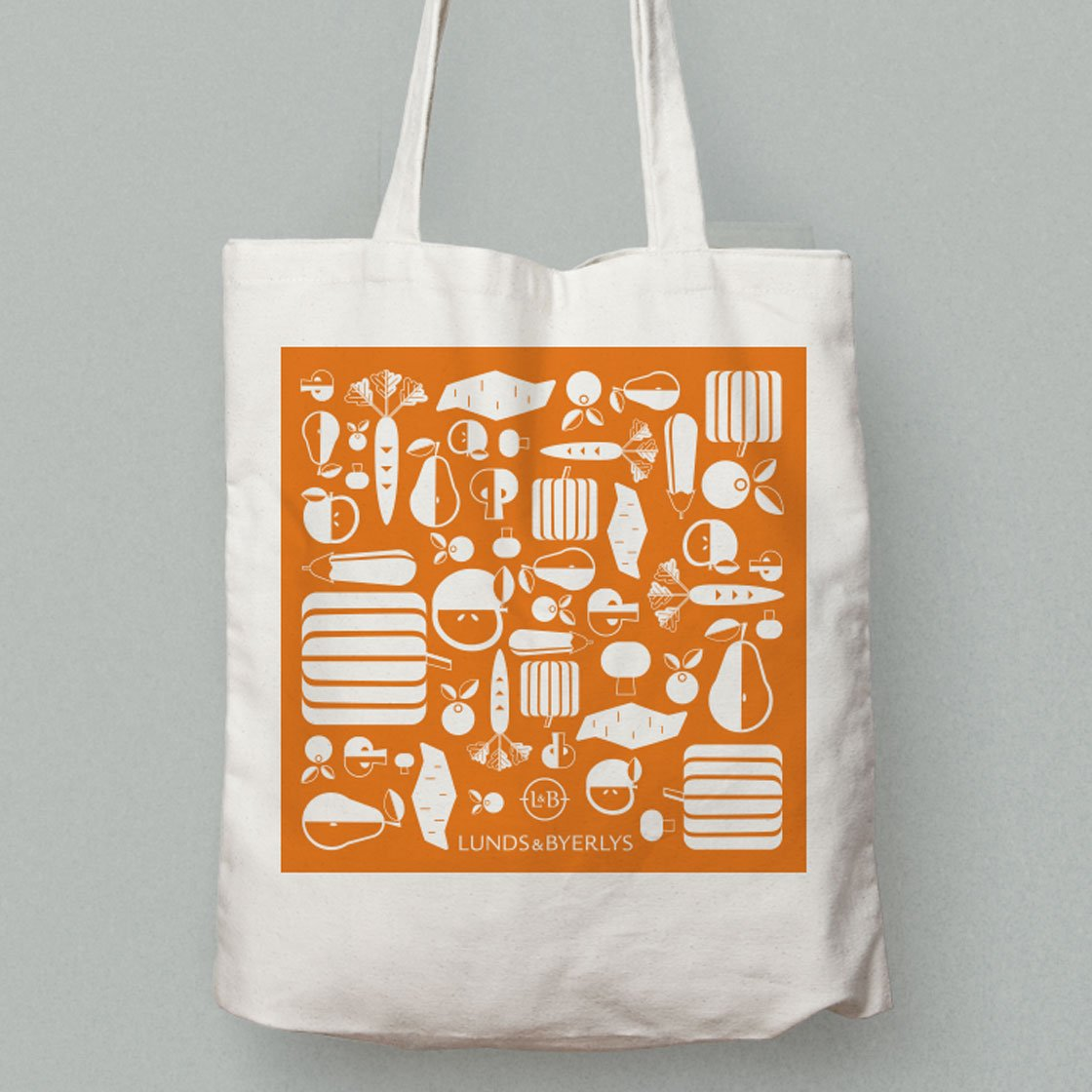 Tote bag with a screen printed design of fruits and vegetables