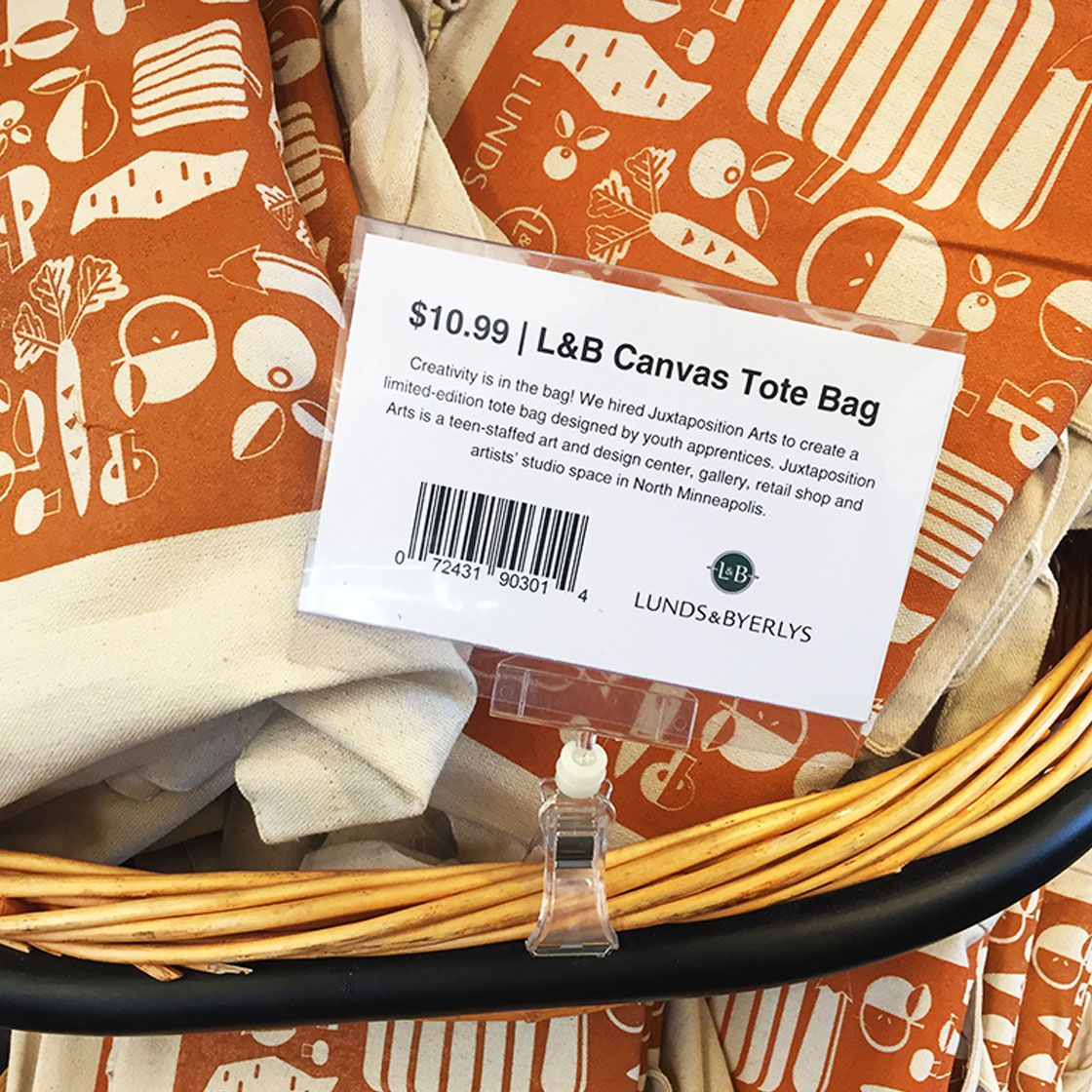 A basket with screen printed tote bags