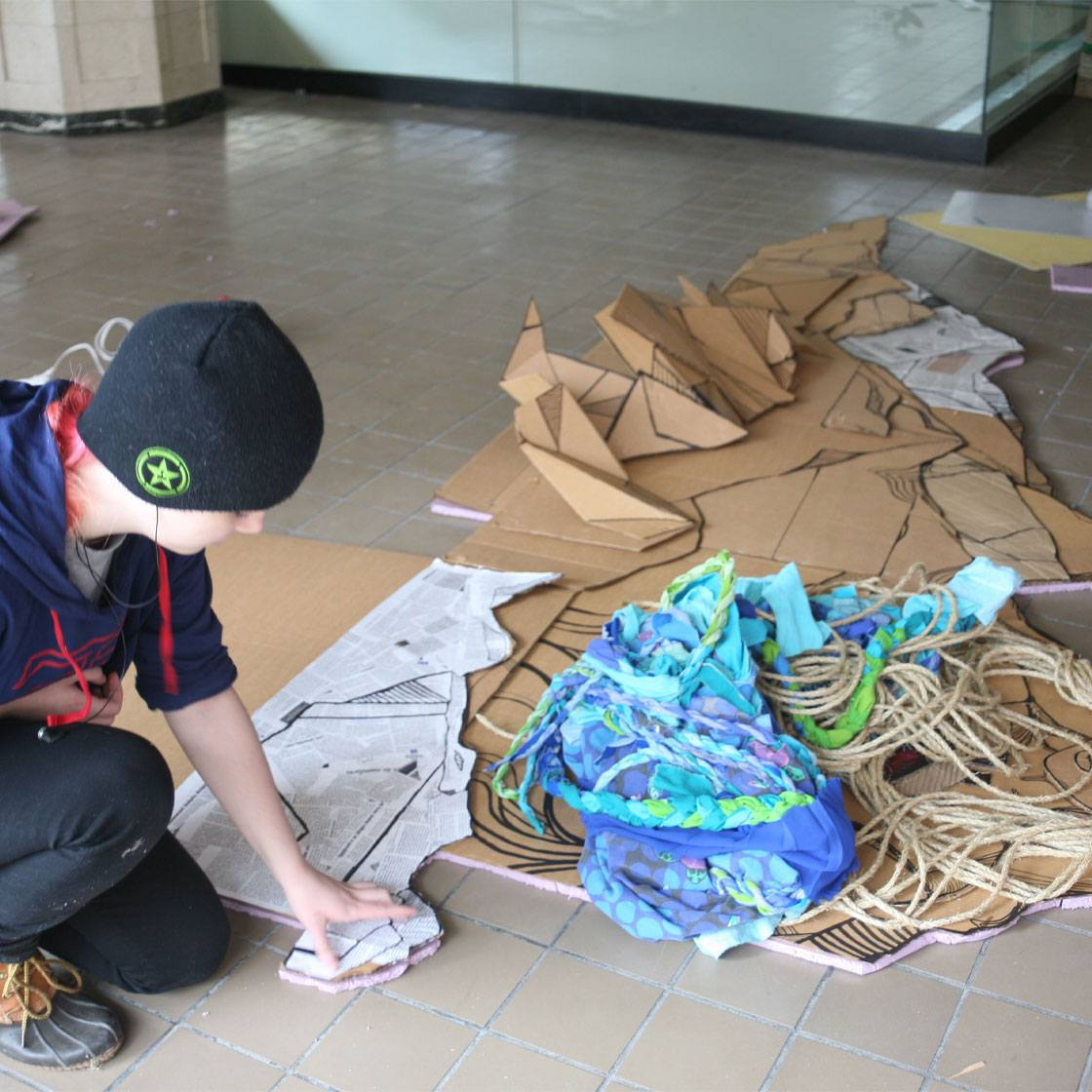 A young person working on a multimedia art project