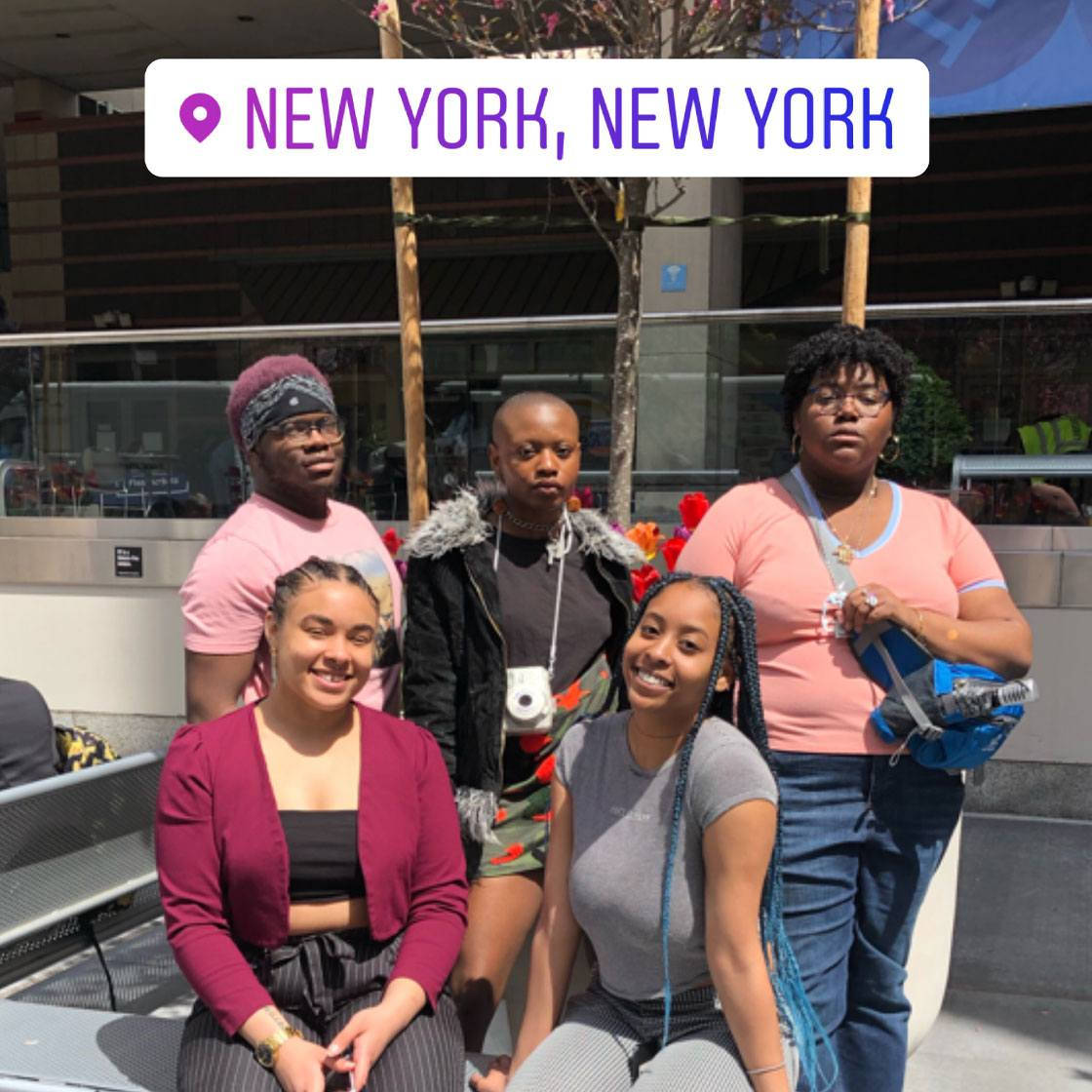 A group of 5 people posing with a text tag location new york, new york