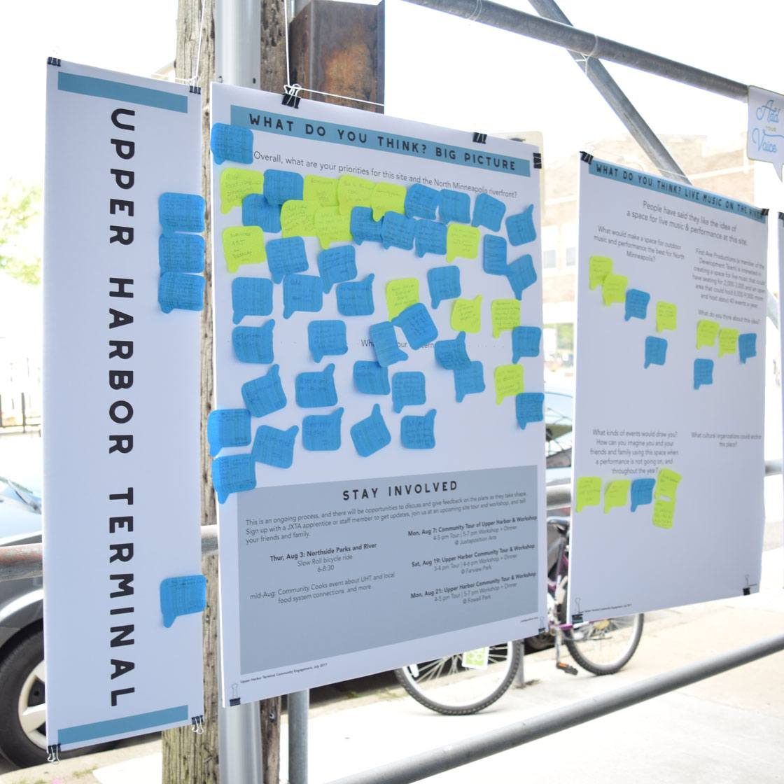 A poster board with the words upper harbor terminal and post it notes