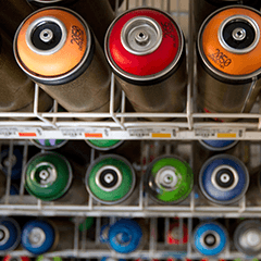 A placeholder image of spray paint cans.