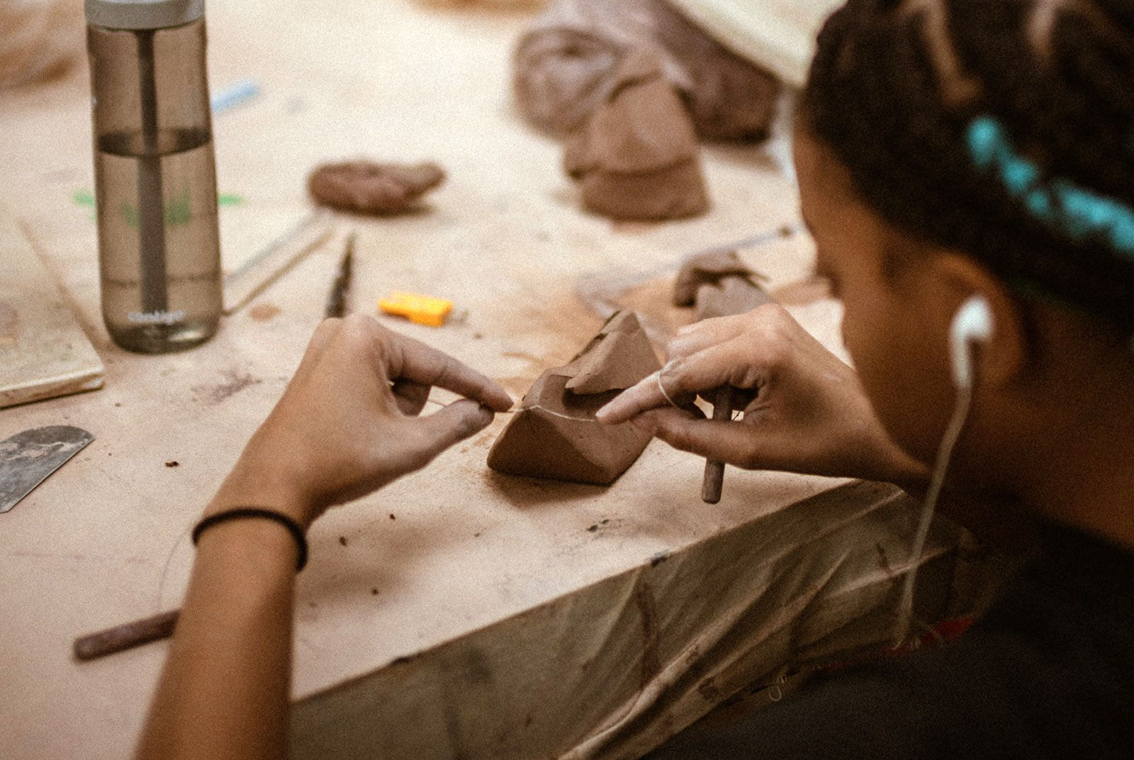 A young person working on a clay project.