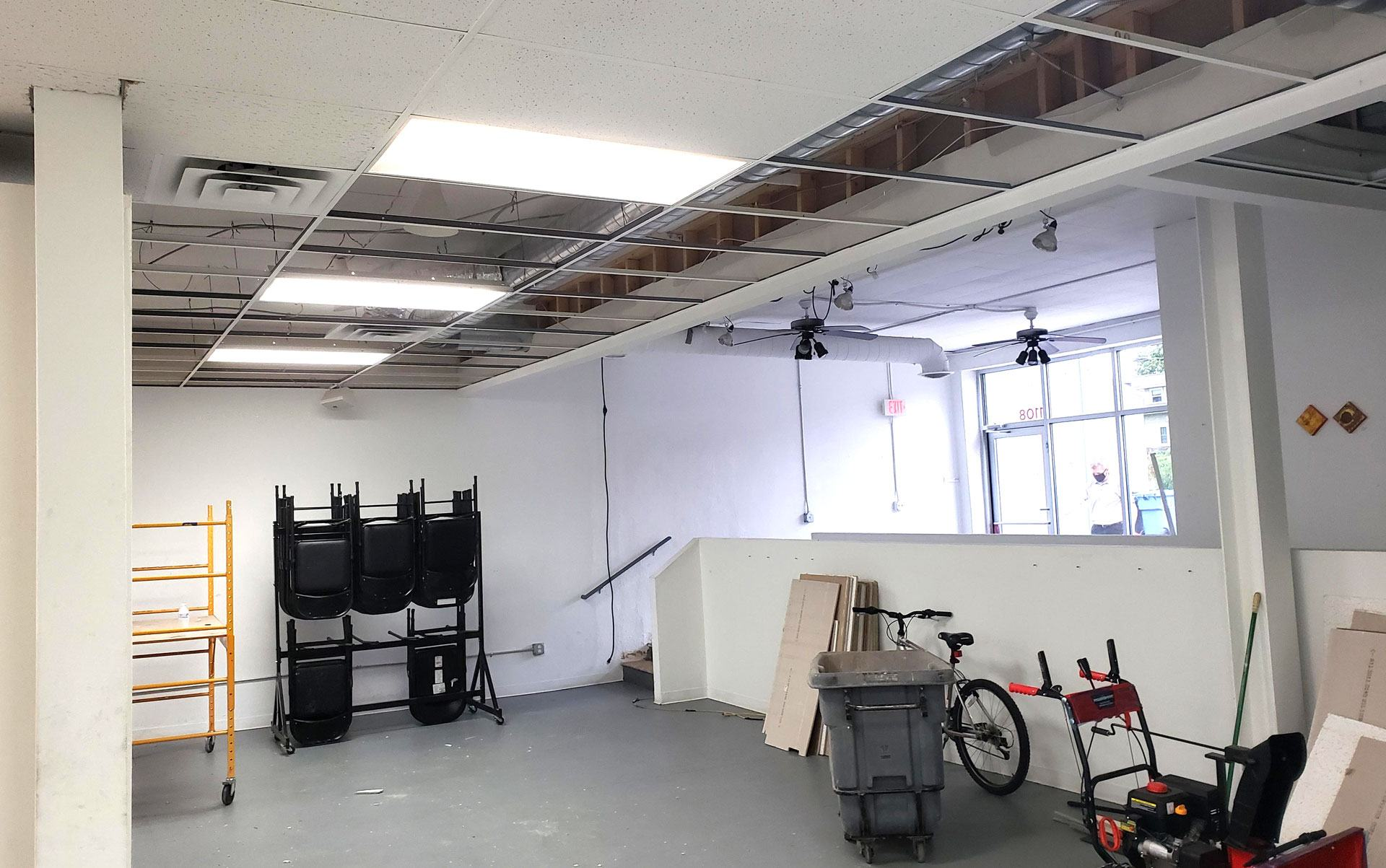A partially empty, sparsely furnished and decorated studio space