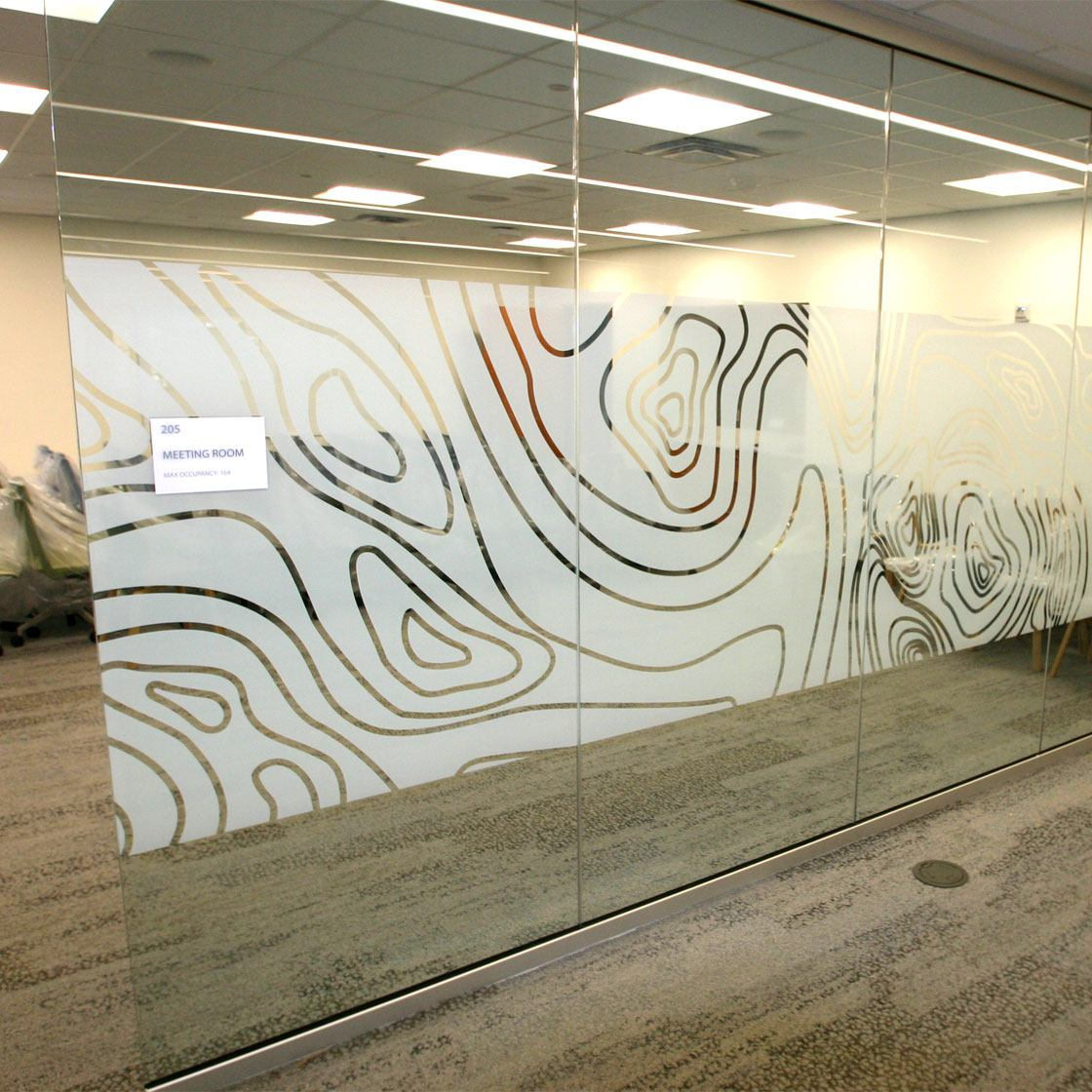 Library conference room, with decorative etchings on the glass wall.