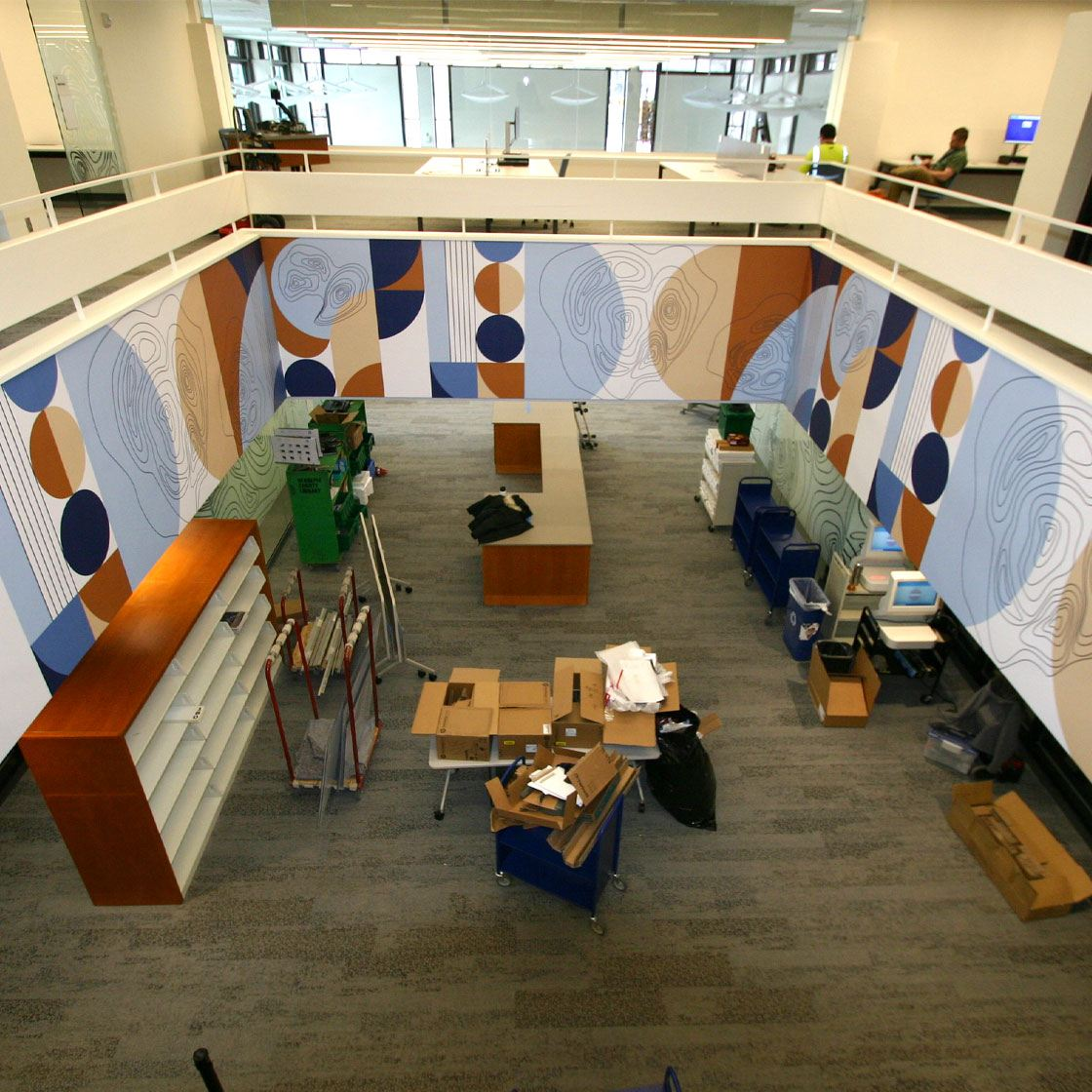 North Regional Library study area from above on a balcony with a decorative design on the balcony walls.