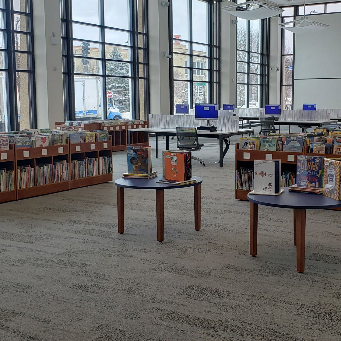 Library display of books and tables.